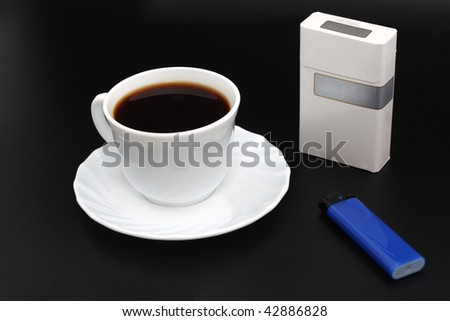 A cup of coffee and cigarettes - stock photo