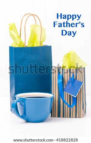 A cup of coffee and gifts for dad on fathers Day. - stock photo