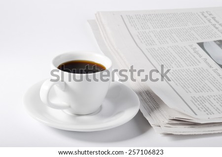 A cup of coffee and newspaper on white background.