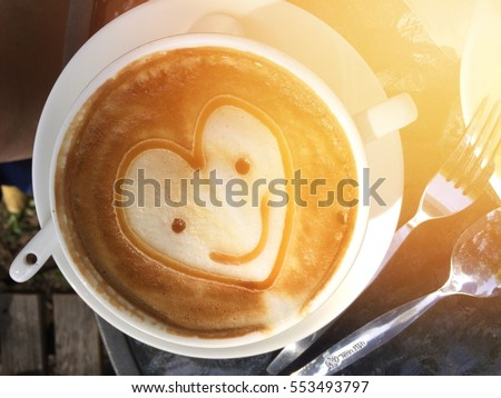A Cup Of Coffee Decorations With Caramel And Cream With A Smile Heart Shaped And