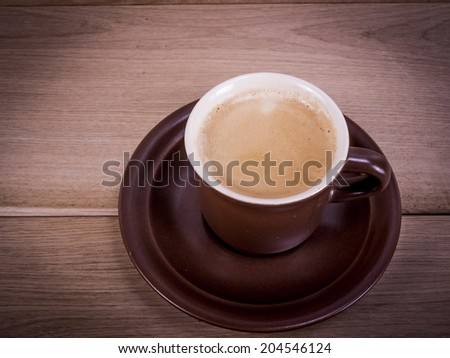 A cup of coffee espresso on brown - stock photo