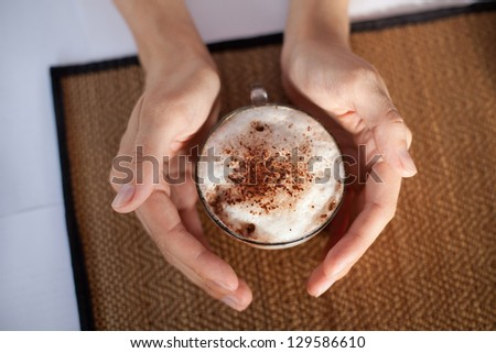 a cup of coffee in hands - stock photo