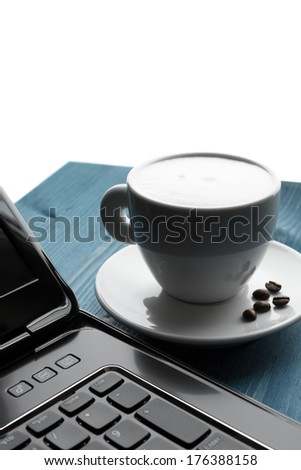 a cup of coffee, laaptop - stock photo