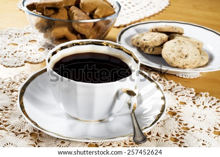 A cup of coffee, lace doily, wooden table, rustic style. Selective focus - stock photo