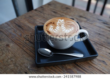 A cup of coffee mocha on wooden  - stock photo