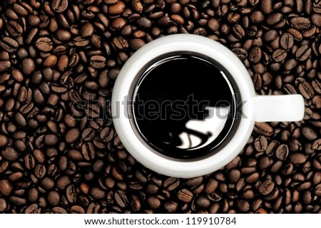 A cup of coffee on a background coffee grains - stock photo