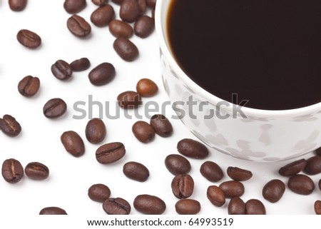 A cup of coffee on coffee beans background