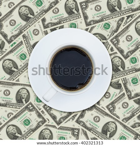A cup of coffee on money dollar bill pattern background