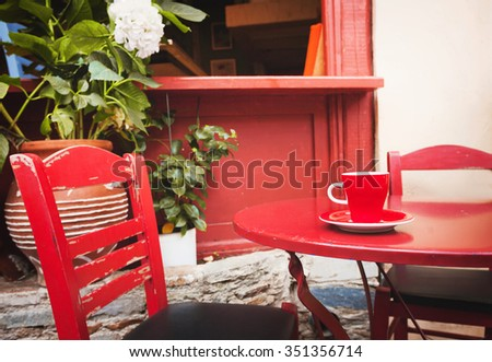 A cup of coffee on table, mediterranean style - stock photo
