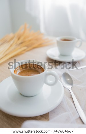 a cup of coffee on the wood table , top view,