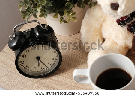 A Cup of coffee on wooden table in morning time