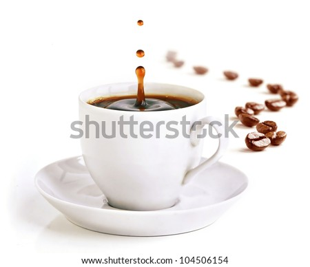 A cup of coffee with a splash of drops in the morning and coffee beans draw a zigzag line in background. - stock photo