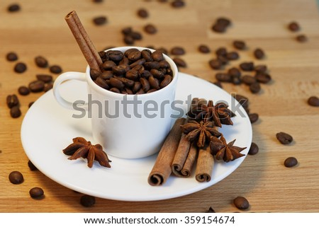 a Cup of coffee with cinnamon and anise - stock photo