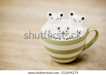 A cup of coffee with cute 3D latte art - stock photo