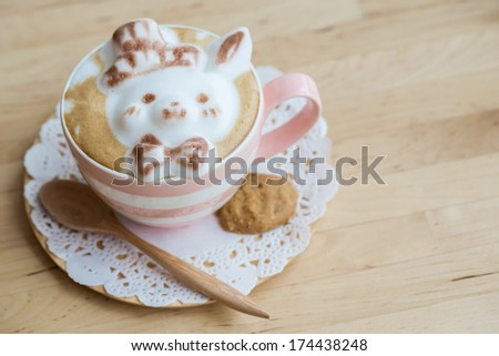 A cup of coffee with cute latte art - stock photo