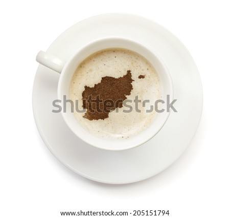 A cup of coffee with foam and powder in the shape of Afghanistan.(series) - stock photo