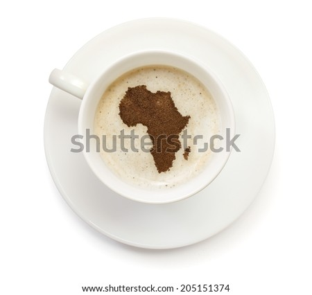 A cup of coffee with foam and powder in the shape of Africa.(series) - stock photo
