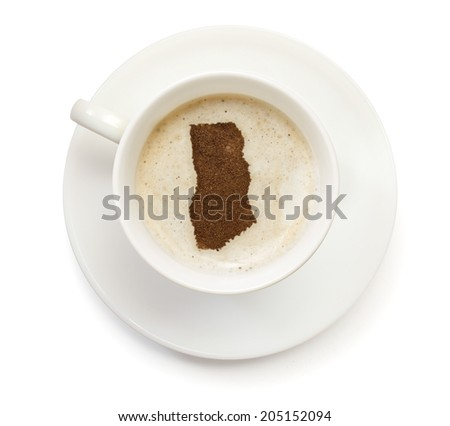 A cup of coffee with foam and powder in the shape of Ghana.(series) - stock photo