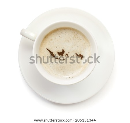 A cup of coffee with foam and powder in the shape of Indonesia.(series) - stock photo