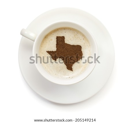 A cup of coffee with foam and powder in the shape of Texas.(series) - stock photo