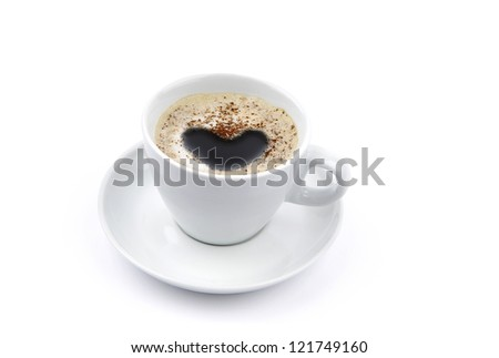 A cup of coffee with foam, shaped into a heart
