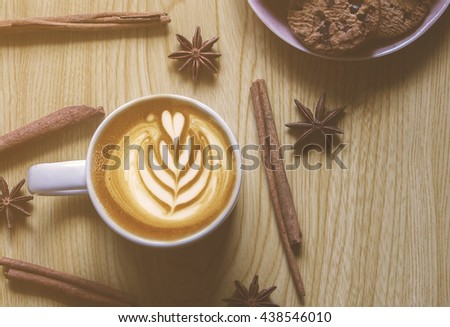 A cup of coffee with latte art , Adjusted with Art filter  - stock photo