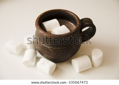 A cup of coffee with marshmallow