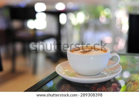 A cup of espresso coffee on bar counter - stock photo