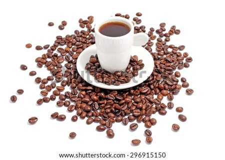 a cup of espresso with coffee beans on white - stock photo