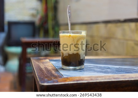 A cup of Giang egg coffee in Hanoi, found in 1946. The coffee is brewed in a small cup with a filter before the addition of a well-whisked mixture of the yolk and other ingredients - stock photo