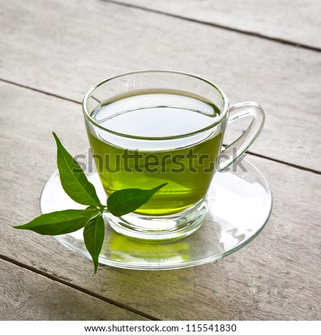 a cup of green tea on wood board, drink for health - stock photo