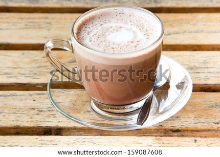 A cup of Hot chocolate on wood table - stock photo