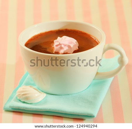 A cup of hot chocolate with mini meringue cookies - stock photo