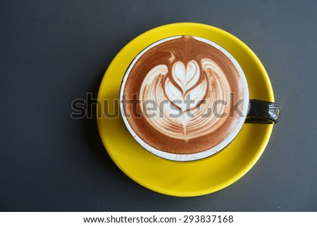 A Cup of hot latte art coffee - stock photo