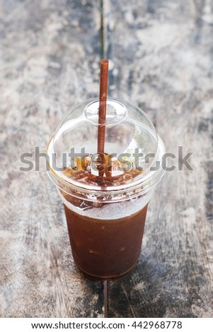 A cup of Ice coffee on wooden table in coffee shop. - stock photo