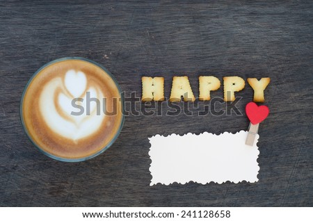"A cup of latte art and alphabet ""happy "" made from bread cookies - stock photo"