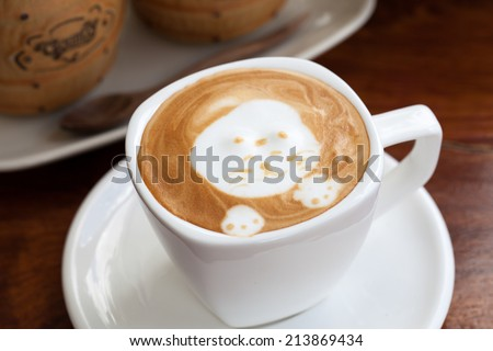 A cup of latte art coffee. - stock photo