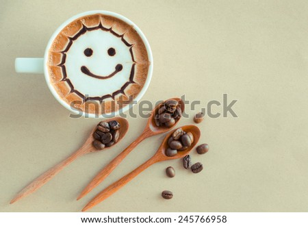 a cup of latte art on brown paper background - stock photo