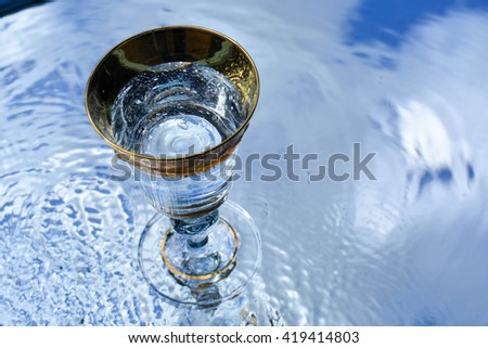 a cup of pure water, reflection, abstract background,