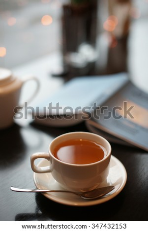 A cup of tea and a book on the table