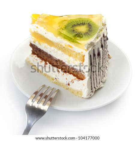 A cup of tea and a piece of tasty creamy cake with fruits - stock photo