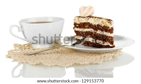 A cup of tea and delicious cake isolated on white