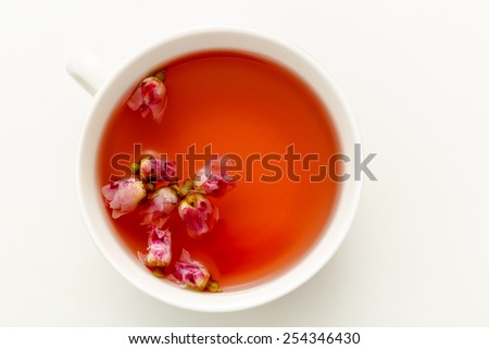 a cup of tea from the flowers of roses - stock photo
