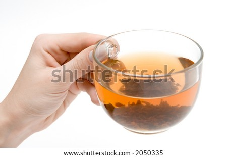 a cup of tea in hand