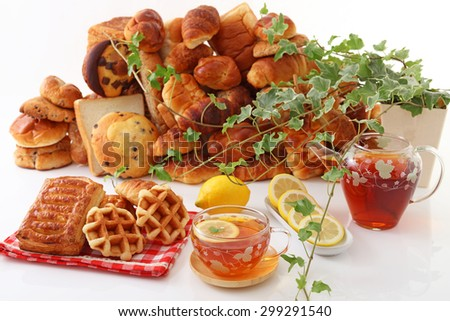 A cup of tea with breads - stock photo