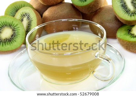 a cup of tea with fresh apple and kiwi
