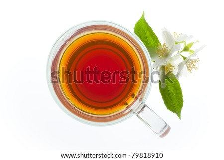 a cup of tea with jasmine flowers isolated on white