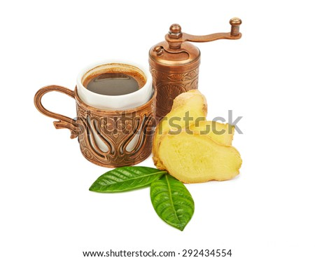 A cup of Turkish coffee with ginger isolated on white background - stock photo