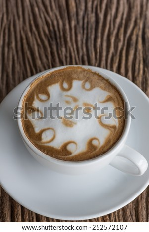 a cup of vintage coffee on the old wood background