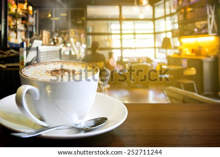 A cup ofCappuccino with retro style coffee shop background - stock photo